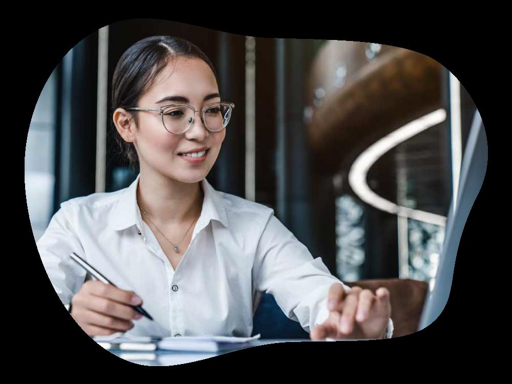 Business woman happily monitoring company's finances via laptop